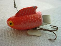 Vtg Antique Fishing Lure Weighty Metal w Rubber Tail Orange White 3 inch F1012 #UnbrandedGeneric Seller florasgarden on ebay