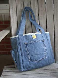 We made our Bayleigh tote in a smaller size so we could use a pair of upcycled jeans. We think it turned out pretty cute! This tote has two Upcycle Jeans Tote by LiliAndLibby on Etsy Denim tote bag with pockets, Bolso con bolsillo Upcycling Bag from Old D Denim Tote Bags, Denim Purse, Denim Bags From Jeans, Diy Jeans, Jean Diy, Denim Ideas, Denim Crafts, Recycled Denim, Fabric Bags