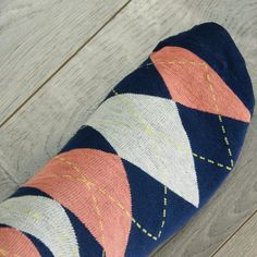 Complete your coral and navy blue wedding with matching argyle groomsmen socks. Wedding budget friendly. #wedding #weddinginspiration #weddingbudget #weddingaccessories #wiw #weddingdiy #socks