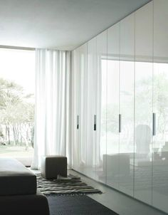 High gloss soft white fitted wardrobes