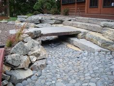 I love the big slab over the bed !! dry creek bed garden design | japanese garden project after.JPG