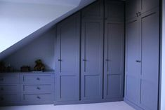 Our fitted furniture is constructed to maximise the storage space in your loft. From fitted wardrobes to free standing bedside tables, we can design the right fitted furniture for your loft conversion. Attic Bedroom Designs, Attic Rooms, Attic Spaces, Bedroom Loft, Upstairs Bedroom, Attic Bathroom, Bathroom Curtains, Loft Conversion Wardrobes, Loft Conversion Bedroom