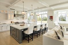 The roughly 1,100-square-foot kitchen of Akiva Fishman in Southampton, N.Y., includes a 12-foot calacatta marble island, three sitting areas and duplicate appliances for family living.