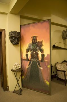 Theme Complete   Antique looking furnishings, props on the walls and these giant framed images, complete the theme of the office. And yes! This one is a secret door too!