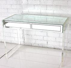 mirror & lucite desk, white brick wall, white wood floors