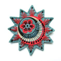 APPLIQUE ORIGINALS:blog with interesting designs for felt appliqué, pins, etc (artist, no instructions)
