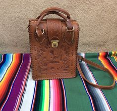 A personal favorite from my Etsy shop https://www.etsy.com/listing/233981236/vintage-1970s-mexican-floral-tooled
