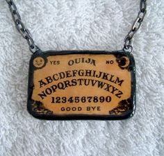Make your own Ouija board necklace? Yes! Perfect for All Hallows Eve!!!