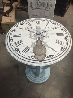 French clock table.  Chalk painted base.  Clock image was done using stain.  Stain shading, stain painting