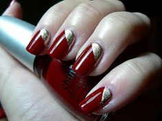 Gold triangle on the bottom of red nail