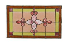 original early 20th century american interior residential stained glass transom window with unusual central floral motif