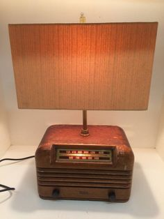 Vintage Radio Turned into a unique One of a kind Lamp. Stop By @wbpropertydept & Check Out this Newly Re-designed Fixture!