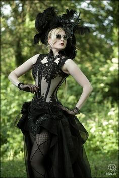 Full lace, texture, stockings, feathers, silk, all black with corset. Classic Victorian Steampunk style.