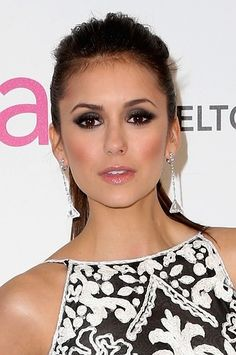 Nina Dobrev paired dark smokey eyes and flushed cheeks for Elton John's Oscar Viewing Party