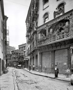 Doyers Street, Chinatown, New York. A wholesome neighborhood where milk can be purchased by the glass circa 1901.