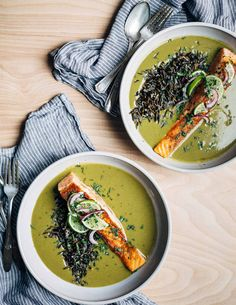 A warming meal for busy times – nourishing green soup with creamy coconut milk and wild rice topped with a pan-seared salmon fillet