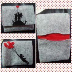 Portafoglio Banksy in feltro, con chiusura magnetica.