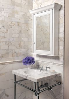 Stunning Powder Room With Calcutta Gold Marble Tiled Walls Featuring A  Larger Tiled Lower Wall, Trimmed With Chair Rail Tile Alongside Smaller  Calcutta Gold ...