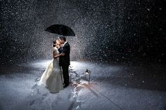 Ridiculously phenomenal night winter snow wedding image by Dennis Pike Photography, via Flickr. It looks like he used at least two off camera flashes to illuminate this amazing photograph.