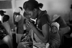 Mother and child during prayer time at a church in rural Zimbabwe.