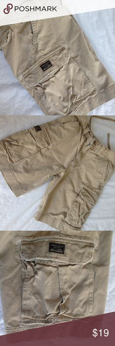 Abercrombie Cargo Tan Shorts Abercrombie tan distressed cargo shorts. This brand of abercrombie is usually for approx middle school age kids. Size 14. These have a distressed faded look and purchased this way. 100% cotton. Interior drawstring to tighten if needed. In very good pre used condition abercrombie  Bottoms Shorts