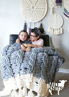 This symmetrical Super Chunky Reversible Cable Throw Blanket / Rug sports matching twisted cables on both the front, and back side, and a tassel border. It is crocheted using multiple strands of acrylic yarn to create a modern over-sized blanket. These written instructions also include photos for pattern clarification making it an easy to follow how-to.