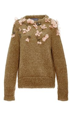 This **Monique Lhuillier** sweater features a relaxed, oversized fit and floral embroidery through the chest and shoulders.