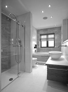 55 Sleek Modern Master Bathroom Ideas (Photos) This bathroom has an impressive rain shower, a rounded basin, and a window side tub – what more could you want? Bathroom Design Luxury, Modern Bathroom Design, Luxury Bathrooms, Modern Luxury Bathroom, Luxury Shower, Bathroom Tile Designs, Dream Bathrooms, Grey Bathrooms Designs, Tiled Bathrooms