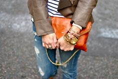 wrist bling + love the orange/rust clutch