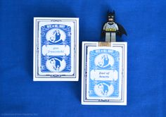 Greatest Story Weddings | Playing Card Escort Cards that doubled as Favors for guests | Playing Card label features subtle hidden details like the Batman and Wonder Woman symbols in the corners