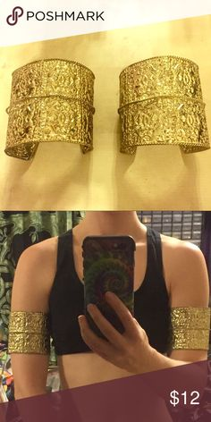Metal arm band cuff costume goddess bracelet gold 2 gold tone metal arm cuffs! Perfect for music festivals concerts raves belly dancing or your next Halloween costume. They bend in and out to secure around the bicep or wrists. Tags: boho bohemian hippie hippy tribal Greek goddess queen cleopatra Arabian genie Aladdin Jasmine Wonder Woman warrior jewelry outfit bracelet medieval cosplay Renaissance ren faire larp sca bracers marvel D.C. Comics nerd geek Jewelry