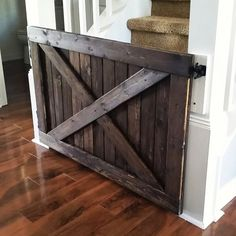 Tired of ugly plastic baby gates that always seem to break or never close properly? Or do they tend to clash with the decor of your beautiful home? Well why not have the functionality of a sturdy wooden baby gate combined with the rustic style of a barn d Diy Dog Gate, Barn Door Baby Gate, Diy Baby Gate, Door Gate, Baby Door, Pet Gate, Rustic Barn, Rustic Style, Wooden Barn