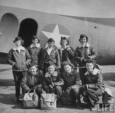 Team of American flight nurses posing in front of one of their C47s ~