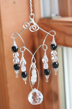 This unique gemstone suncatcher is handmade with Black Tourmaline, Clear Quartz, Pink Kunzite and Selenite. These gemstones work together to protect your mind, body and spirit from all kinds of negative energies, while providing a centering influence that helps you to remain calm, focused and joyful in any situation.
