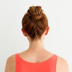 Braid three small braids up the back of your head to create this bun.
