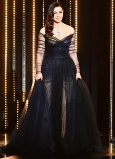 Best Dressed Stars on Cannes Red Carpet 2017 MONICA BELLUCCI The actress opens Cannes as the master of ceremonies in a voluminous black tulle Dior Couture gown featuring a sheer skirt and low-neckline, plus a statement diamond pendant necklace.