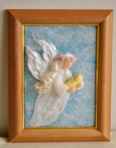 Waldorf inspired needle felted Fairy Tale/ Wool Picture: The Fairy with Baby. $48.00, via Etsy.