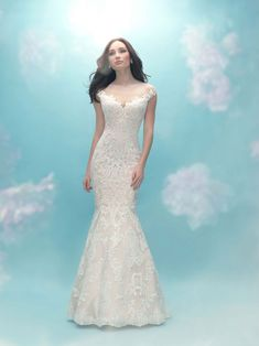 Allure Bridals 9474 is a stunning lace wedding gown that features an off the shoulder illusion neckline and a gorgeous mermaid silhouette, designed to show off your hourglass figure. The sheer lace back is accompanied by button closure for a classic look. Dressy Dresses, Modest Wedding Dresses, Designer Wedding Dresses, Bridal Dresses, Wedding Gowns, Bridesmaid Dresses, Lace Wedding, Debutante Dresses, Wedding Gown Gallery