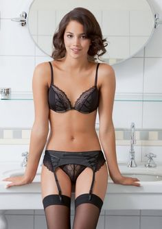 wow. sHE is perfect in her bra and panties and garter belt and stockings. Id love to meet my man at the door like this...