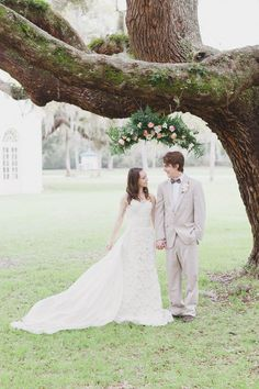 Flowers hanging from the tree. What a delightful ceremony idea! @He Y Wedding Lady