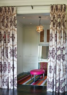 Walk in closet with curtain panels. Design Connie Braemer.