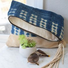 The inside is fully lined and each bag comes with a fun tassel zipper pull. Indigo patterns vary and it's only $78! Unexpected designs infused with vibrant colors and striking style inspires a unique sense of joy and admiration that appeals to todays modern sensibility and connected spirit. With a Jamie Lauren Designsoriginal you carry the story forward.  WWW.JAMIELAURENDESIGNS.COM