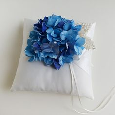 White and Blue Wedding Ring Pillow, Ring Bearer Pillow, Bridal Pillow, Wedding Ceremony Pillow, Ring Holder, Ring Cushion, Fabric Hydrangea A marvelous white and blue wedding ring pillow made of ivory matte satin and finished with a beautiful blue fabric hydrangea flower. This is a Blue Hydrangea Wedding, Hydrangea Flower, Ring Holder Wedding, Ring Pillow Wedding, Ring Pillows, Throw Pillows, Blue Wedding Rings, Cushion Ring, Matte Satin