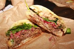 Slow Braised Lamb sandwich--mint pesto, goat cheese, balsamic, pickled onions, arugula from Mendocino