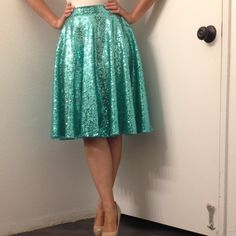"Teal sequin skirt This epic skirt is hand made and is a full circle midi skirt! It's so fabulously wonderful it's beyond words! Photos don't do it justice! A definite must for your posh closet! Skirt is also fully lined with a skin toned liner. Measures 26"" waist and 23"" length Mimi Cariño Skirts Midi"