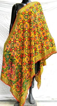 Steal the show at the next party you attend in this stunning phulkari work poly georgette dupatta. It has been heavily embroidered in a vibrant colored floral pattern, with wool thread and sequins - See more at: http://giftpiper.com/Handmade-Phulkari-Work-Georgette-Dupatta-id-224991.html#sthash.YGTCxWMq.dpuf