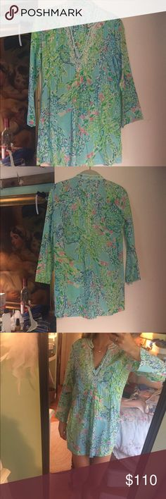 "Lilly Pulitzer Tunic Gorgeous Lilly Pulitzer tunic has been worn once and is EUC practically NWT! Print is""Blue Heaven"". White beading detail in the front and around the collar. Very thin, would be perfect as a beach cover up too. For reference, I am 5'2 and 104 lbs Lilly Pulitzer Tops Tunics"
