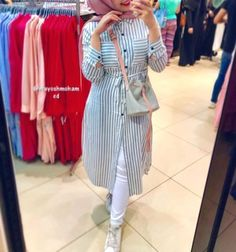 Shirt dresses are the minimal hijab chic outfits that help you look amazing and modest for this season. Shirt dresses looks perfect for weekends and to those Hijab Fashion Summer, Modest Fashion Hijab, Fashion Outfits, Hijab Style Dress, Casual Hijab Outfit, Stylish Hijab, Hijab Chic, How To Wear Shirt, Hijab Trends