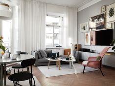 Grey home with modest color details - via Coco Lapine Design blog