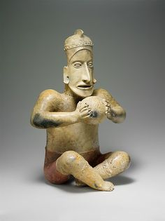 Seated Ballplayer    1st century B.C.–A.D. 3rd century Mexico, Mesoamerica, Jalisco  Ameca-Etzatlán  Ceramic  H. 19 5/8 x W. 13 in.  Images of ballplayers were made in ancient Mexico for millennia. The game, played with a large rubber ball, was fast paced and had many layers of meaning—and it was always a significant male activity. Depictions of both game and players appear in the ceramic sculptures of Jalisco, a state on the west coast of Mexico, where such works were produced